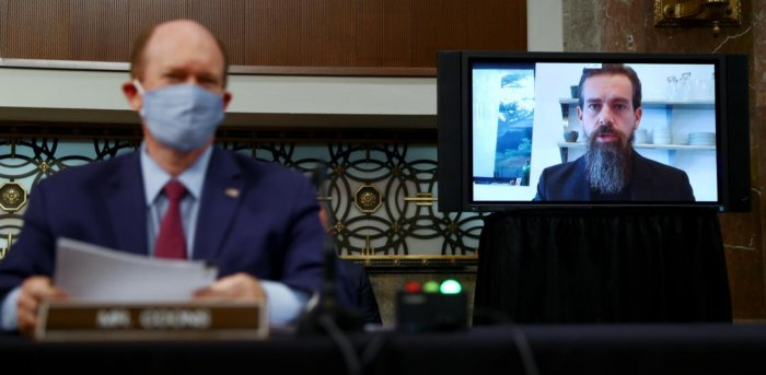 TwitterCEO Jack Dorsey is seen testifying remotely via videoconference as US Senator Chris Coons (D-DE) listens during a Senate Judiciary Committee. Credit: Reuters Photo