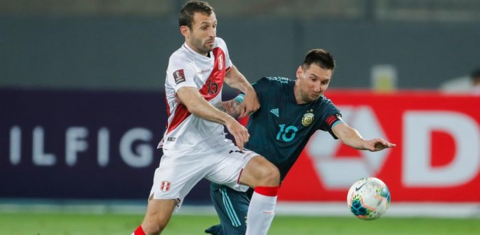 Argentina's Lionel Messi and Peru's Horacio Calcaterra. Credit: AFP Photo