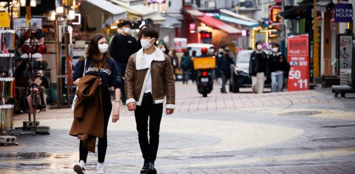 Pedestrians wearing masks walk on a shopping street amid the coronavirus disease in South Korea. Credit: Reuters Photo