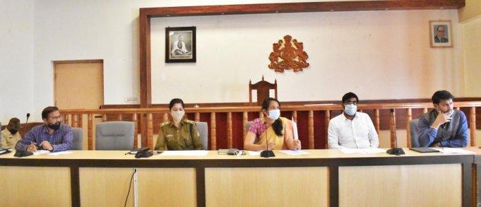 Deputy Commissioner Annies Kanmani Joy speaks at a meeting in Madikeri on Wednesday.