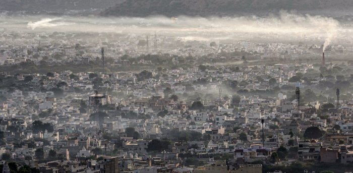 Ajmer city shrouded in haze during morning hours, in Ajmer. Credit: PTI Photo