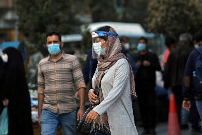 An Iranian woman wears a mask and face shield, amid a rise in the coronavirus disease in Tehran. Credit: Reuters