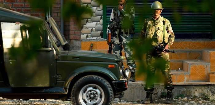 The encounter was underway till last reports came in, they said, adding that four terrorists are believed to be in the vehicle. Credit: AFP Photo