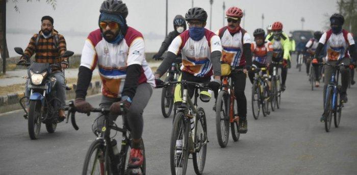 """Cyclists participate in a para-cycling expedition """"Infinity Ride 2020"""" from Kashmir to Kanyakumari, at Dal Lake in Srinagar. Credit: PTI."""