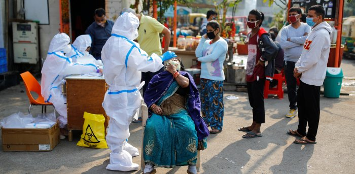 The national capital reported 7,456 coronavirus cases on Thursday and the city's positivity rate was 12.09 per cent. Credit: Reuters