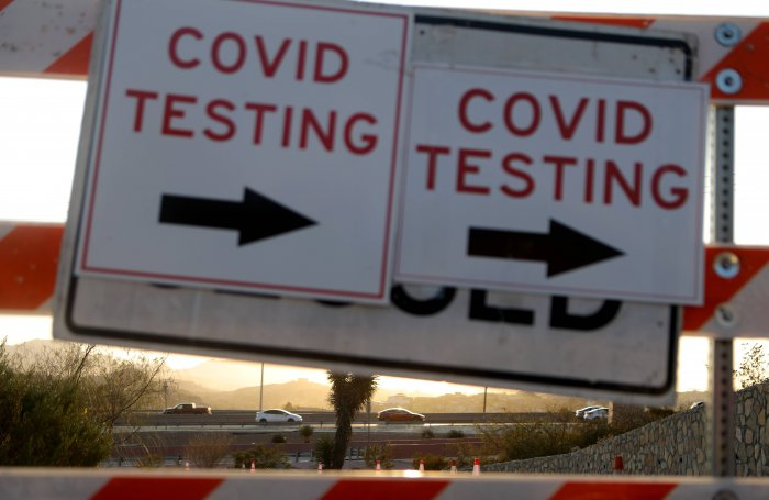 A sign is displayed at a drive-in COVID-19 testing site amid a surge of coronavirus cases in the city on November 18, 2020 in El Paso, Texas. Texas surpassed 20,000 confirmed coronavirus deaths on November 16, the second highest in the U.S., with active cases in El Paso now over 34,000 and confirmed COVID-19 deaths at 804. Credit: Getty Images/AFP