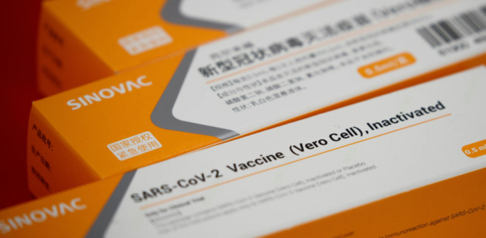 A display shows packages of vaccine candidate for SARS-CoV-2 by Sinovac Biotech during a government-organized media tour showcasing the company's development of a coronavirus disease vaccine candidate in Beijing, China, September 24, 2020. Credit: Reuters File Photo