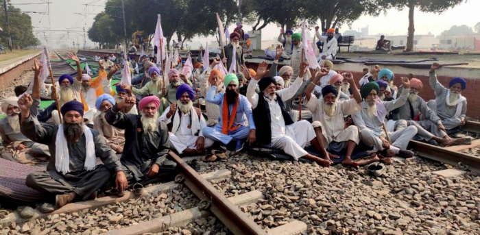 Farmers block a railway track during a protest against the new farm law, at Jandiala Guru in Amritsar. Credit: PTI Photo