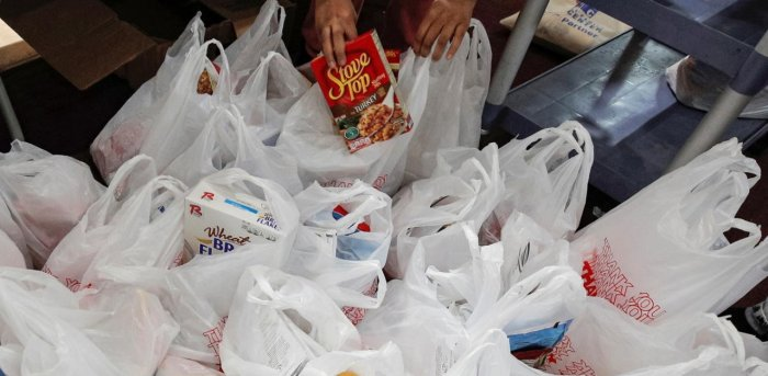 Bags of free holiday food and Thanksgiving turkeys. Credit: Reuters Photo
