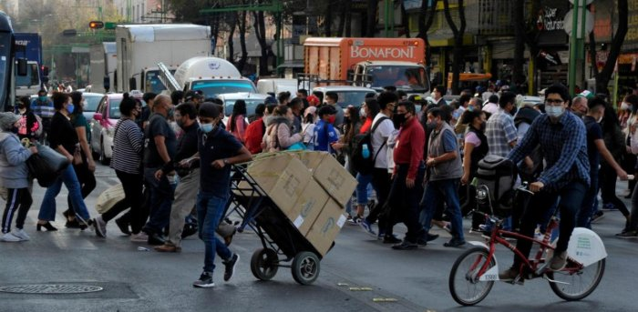 People cross an avenue at the historic center in Mexico City. Credit: AFP Photo