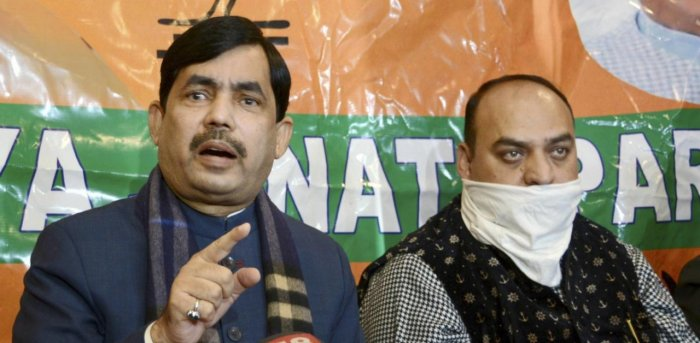 Bharatiya Janata Party (BJP) National spokesperson Shahnawaz Hussain along with senior party leaders ahead of DDC elections. Credit: PTI Photo