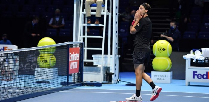 Austria's Dominic Thiem reacts after his victory over Serbia's Novak Djokovic in their men's singles semi-final match on day seven of the ATP World Tour Finals tennis tournament at the O2 Arena in London. Credit: AFP.