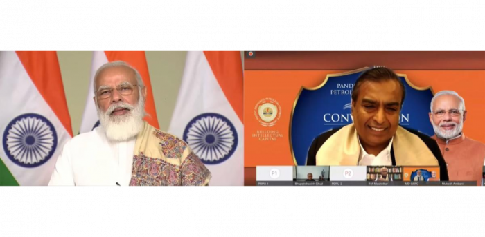Prime Minister Narendra Modi addresses the 8th convocation of Pandit Deendayal Petroleum University. Reliance Industries Chairman and Managing Director Mukesh Ambani is also seen. Credit: PTI Photo