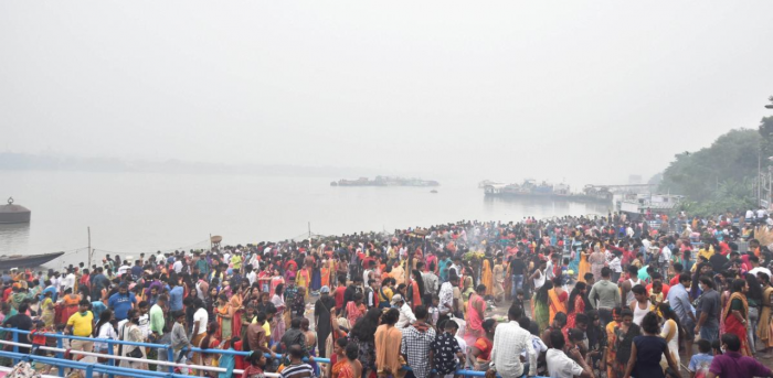 Devotees, flouting social distancing norms, offer prayers to the rising sun after taking bath in the River Ganaga during 'Chhath Puja', in Kolkata. Credit: PTI Photo