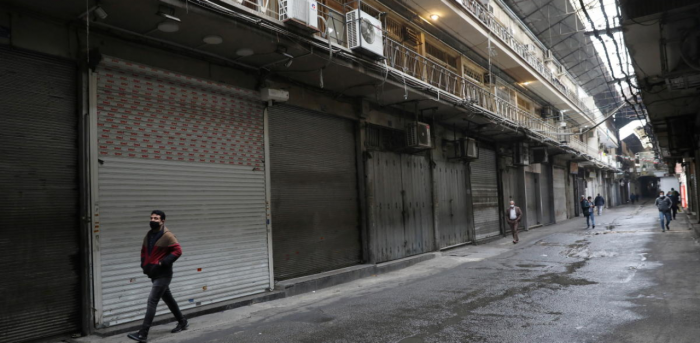 An Iranian man wearing a protective face mask, walks next to closed shops, as government imposed a full lockdown, amid the spread of the coronavirus disease, in Tehran, Iran. Credit: Reuters Photo