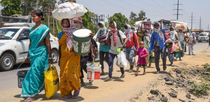 Lakhs of migrant labourers had to walk back to their village due to absence of food, shelter and income during the lockdown. Credit: PTI Photo