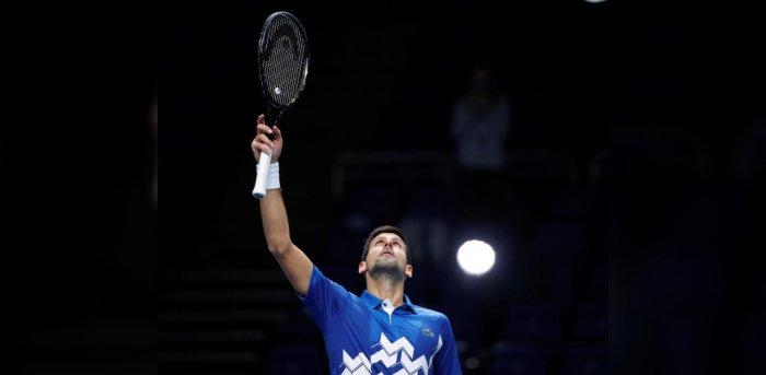 Serbia's Novak Djokovic celebrates winning his group stage match against Germany's Alexander Zverev. Credit: Reuters Photo