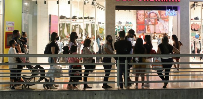 People stand in line in front of a shop at a mall during the Black Friday sales. Credit: Reuters Photo