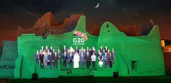 """""""Family Photo"""" for the annual G20 Summit World Leaders is projected onto Salwa Palace in At-Turaif, one of Saudi Arabia's UNESCO World Heritage sites, in Diriyah, Saudi Arabia, November 20, 2020. Credit: Reuters/The Saudi G20 Presidency Media/Handout."""