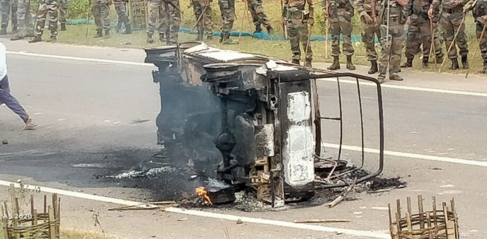 Vehicles set on fire during the highway blockade in Panisagar sub-division in Tripura. Credit: DH Photo