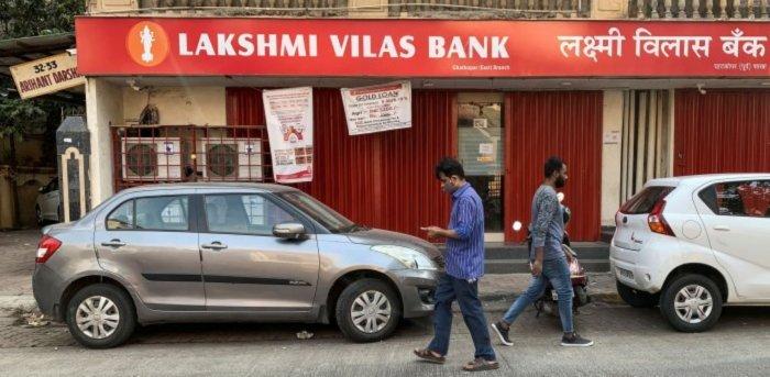 People walk past a Lakshmi Vilas Bank branch in Mumbai, India. Credit: Reuters Photo
