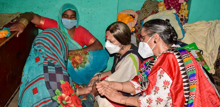 CPI(M) politburo member Brinda Karat meets the family members of a 19-year-old Dalit woman who died after being allegedly gang-raped, at Bulgadi village in Hathras. Credit: PTI Photo