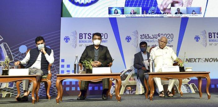 Karnataka Chief Minister B S Yediyurappa, his deputy CN Ashwath Narayan, Minister Jagadish Shettar (R) and MLA Rizwan Arshad(L) listen to PM Modi during Bengaluru Tech Summit on Thursday. Credit: PTI Photo