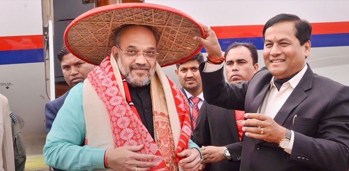 Union Home Minister Amit Shah is greeted by Assam Chief Minister Sarbananda Sonowal at the airport as he arrives to attend the 34th Statehood Day of Arunachal Pradesh, in Lakhimpur Kheri. Credit: PTI File Photo