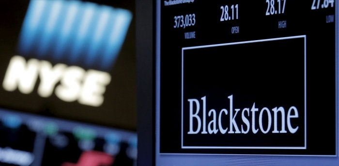 The ticker and trading information for Blackstone Group is displayed at the post where it is traded on the floor of the New York Stock Exchange. Credit: Reuters File Photo