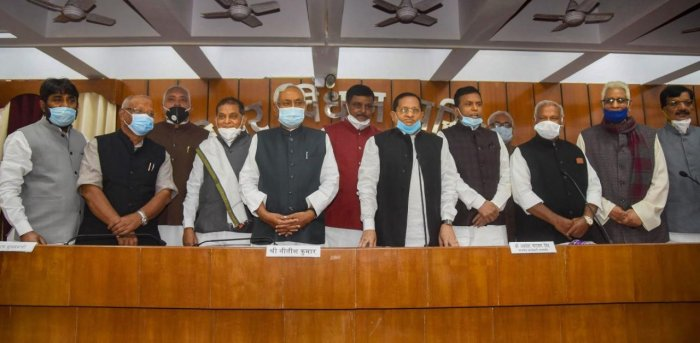 Bihar Chief Minister Nitish Kumar along with Deputy Chief Minister Tarkishore Prasad, Protem Speaker Jitan Ram Manjhi, Chairman of Bihar Legislative Council Awadhesh Narain Singh with newly elected MLCs after oath ceremony at council annex. Credit: PTI.