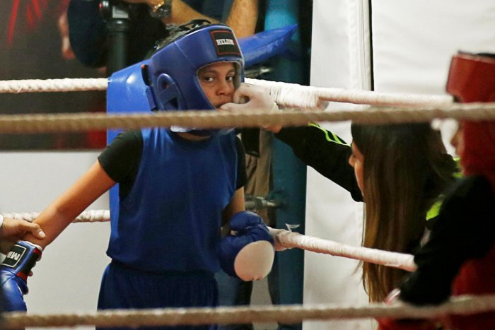 A Palestinian girl takes part in a rare boxing championship in Gaza City. Credit: Reuters