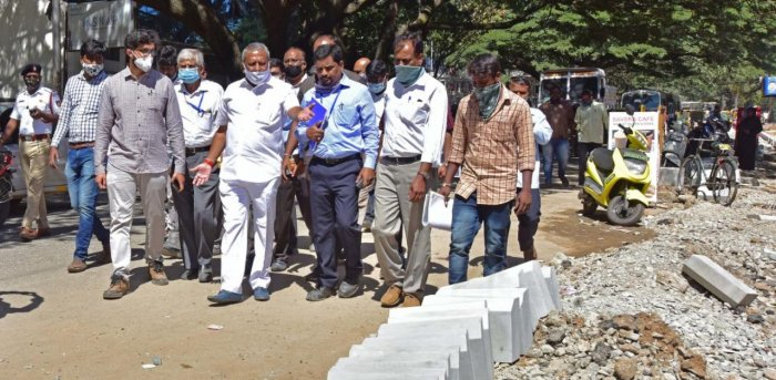 Urban Development Minister Byrathi Basavaraj inspected some of the ongoing roadworks on Friday. Credit: DH photo/Irshad Mahammad.