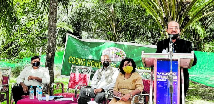 Coorg Homestay Owners' Association president B G Ananthashayana speaks during the annual general meeting of the association in Kushalnagar on Sunday.