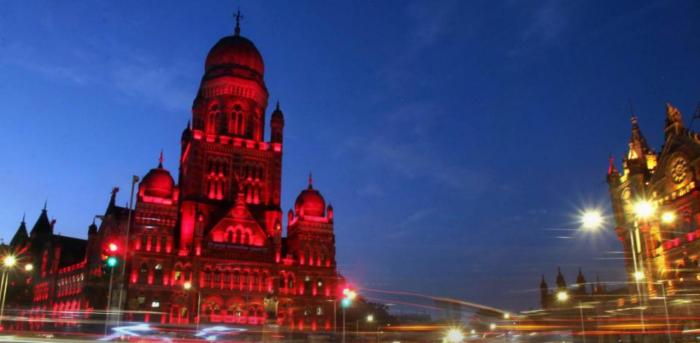 The Brihanmumbai Municipal Corporation (BMC) building is illuminated in red light. Credit: PTI Photo