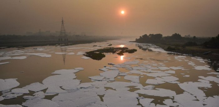 Toxic foam floats in the Yamuna river, during sunset in New Delhi. Credit: PTI Photo