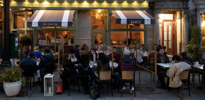 People enjoy outdoor dining as the spread of the coronavirus disease continues, in New York City. Credit: Reuters Photo