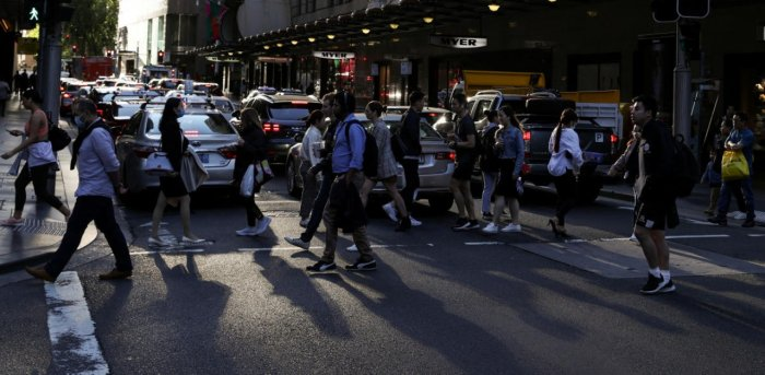 People walk through a congested intersection in the city centre of Sydney, Australia. Credit: Reuters Photo