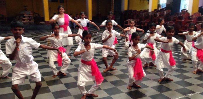 Roopa teaches the kids reading, writing and serves them healthy food. The children learn Karate, while, a choreographer conducts dance classes. Credit: Roopa Ballal