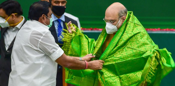 Union Home Minister Amit Shah being greeted by Tamil Nadu Chief Minister K Palaniswami at a programme to declare open the Thervoy Kandigai Reservoir (Chennai's fifth Reservoir) and lay the foundation stone for several infrastructure projects across the state of Tamil Nadu, in Chennai. Credit: PTI