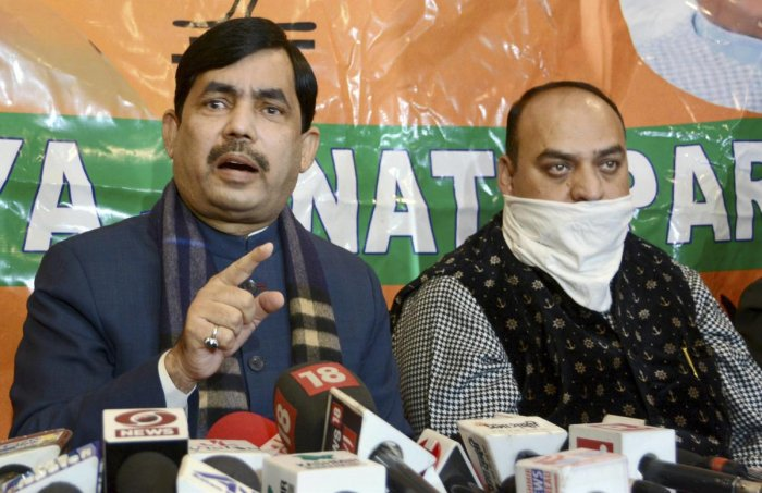 Bharatiya Janata Party (BJP) National spokesperson Shahnawaz Hussain (L). Credit: PTI