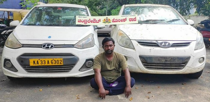 Arrested car dealer Mohammed Muzzamil with the stolen vehicles. Credit: DH photo.