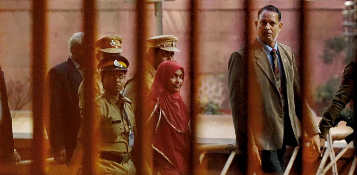 Hadiya, a 24-year-old Hindu woman from Kerala who converted to Islam, leaves the Supreme Court in New Delhi after a hearing in the Kerala 'Love Jihad' case on Monday. Credit: PTI Photo