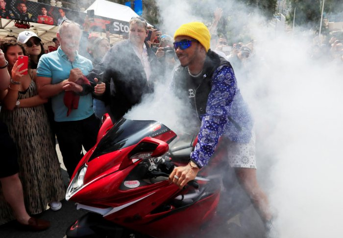 Mercedes' Lewis Hamilton on a motorbike as he leaves the fan zone on Friday. Reuters