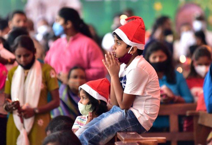 Children pray at St Mary's Basilica, Shivajinagar, Bengaluru, on Christmas Day. DH PHOTO/IRSHAD MAHAMMAD