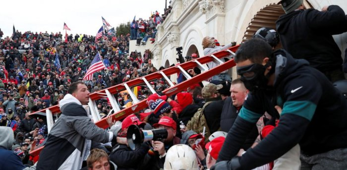 Rioters, many bearing Trump garb, breached the barricades set up by an under-staffed police force and swarmed the Capitol, disrupting the certification of President-Elect Joe Biden's election. Credit: AFP Photo