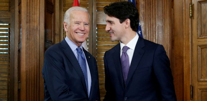 Canada's prime minister, Justin Trudeau (R), shakes hands with then-U.S. Vice President Joe Biden during a meeting in Trudeau's office. Credit: Reuters Photo