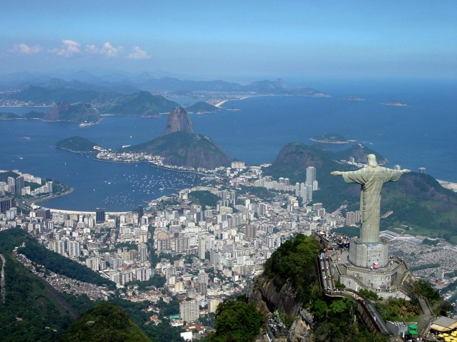 A panoramic view of the statue at the top of Corcovado Mountain with Sugarloaf Mountain (centre) and Guanabara Bay in the background. PHOTO COURTESY WIKIPEDIA