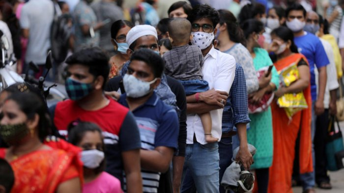 People wait in line to enter a supermarket amidst the spread of the coronavirus disease in Mumbai on April 4. Credit: Reuters file photo.