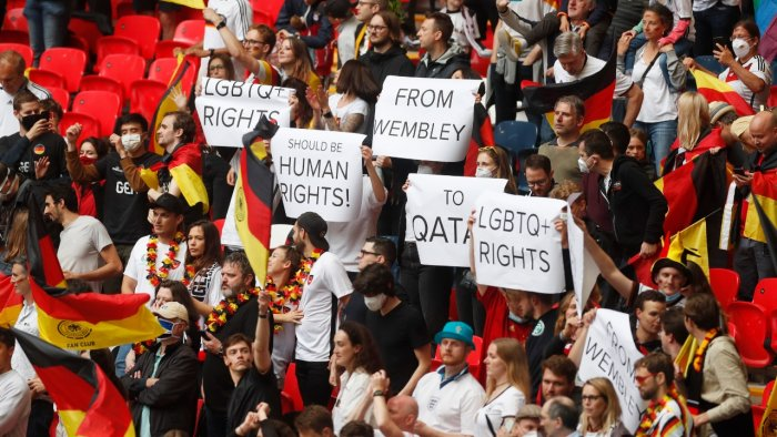 Germany fans hold up banners regarding LGBTQ+ rights before the match. Credit: Reuters Photo