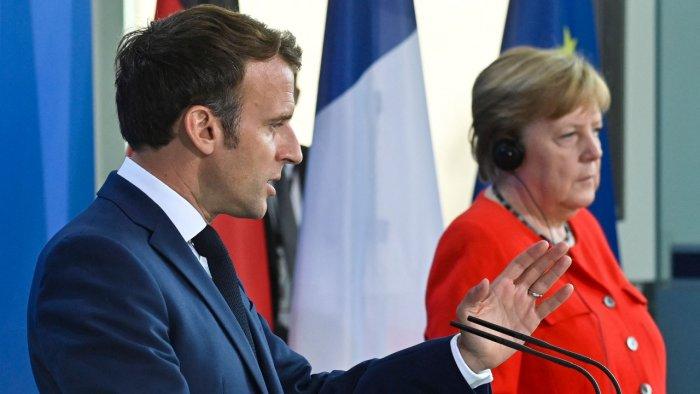 German Chancellor Angela Merkel and French President Emmanuel Macron. Credit: AFP Photo
